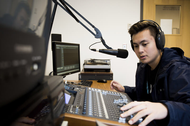 Student in broadcasting booth