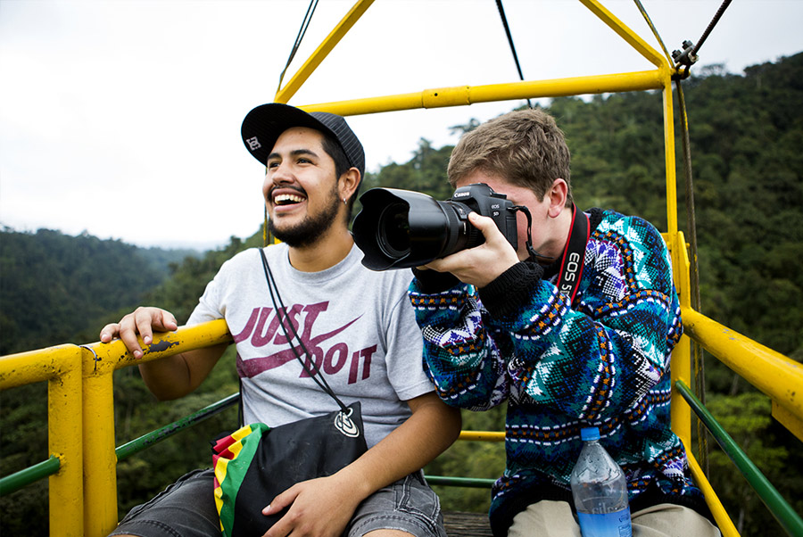 Students taking photos while riding a gondola