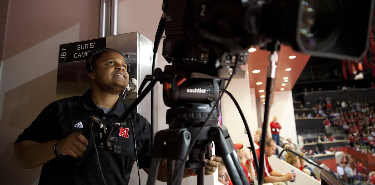 Student working in sports broadcasting during basketball game