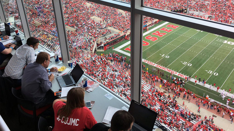 Students in press box at football spring game