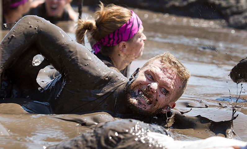 Anna Reed's Photo of race participant swimming in mud pit