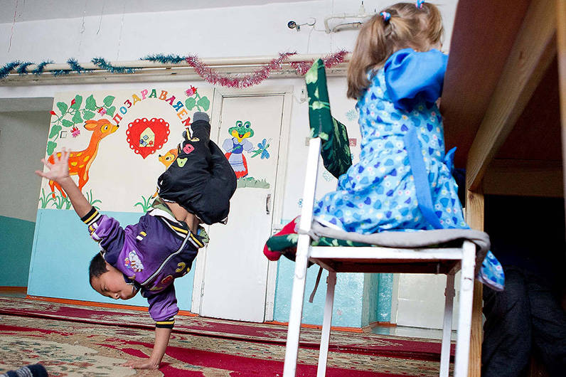 Anna Reed's Photo of a child doing a handstand in a classroom