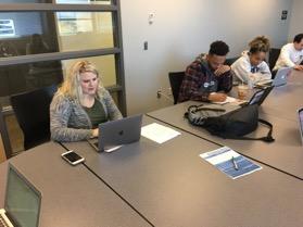 Kelli leads students in class