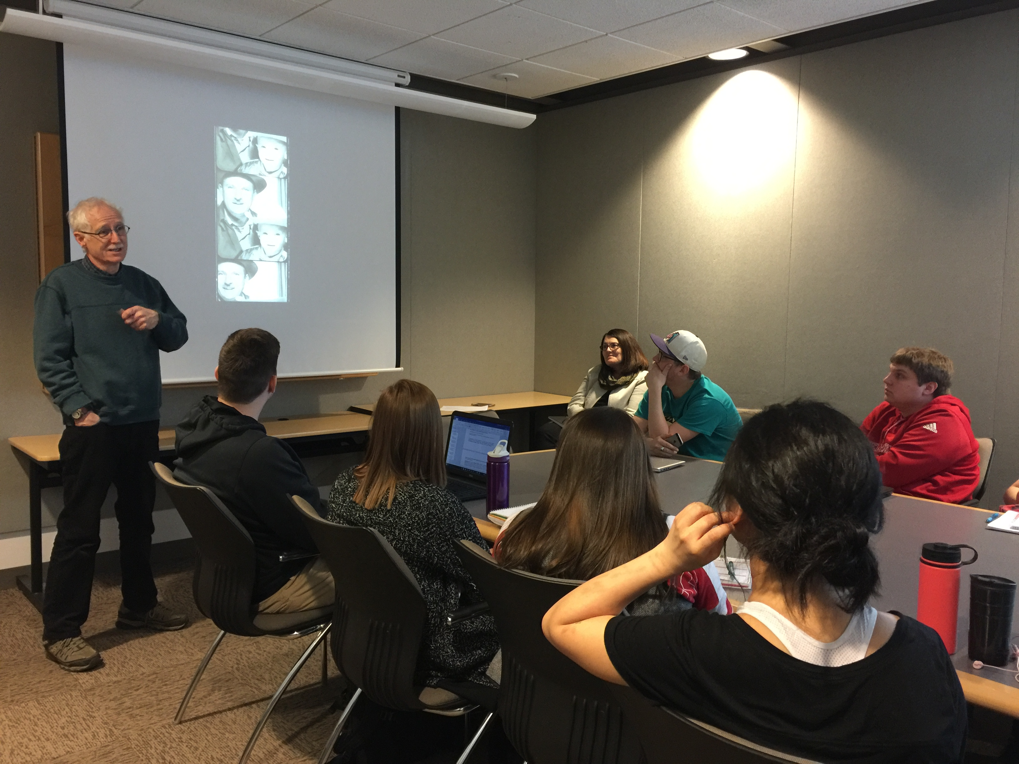 Photographer Jim Lommasson discusses his storytelling projects with students in the Nebraska Mosaic class. (Photo by Abby Groth)
