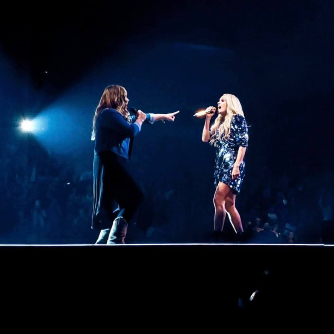 Alex Leavenworth singing with Carrie Underwood