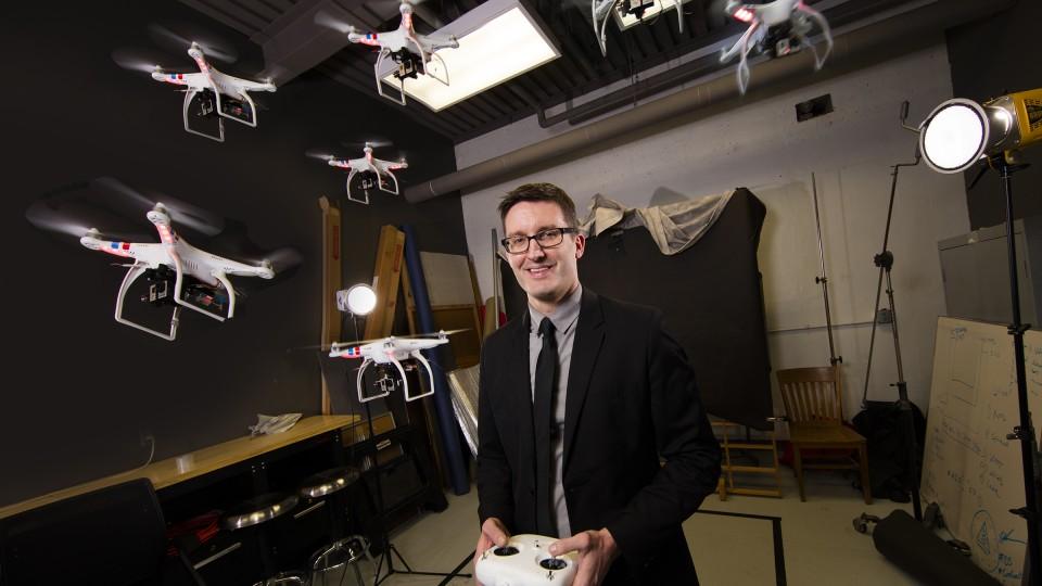 Matt Waite flying drones in Drone Journalism Lab