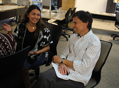 Bob Cullinan works with a student in the CoJMC during his visit