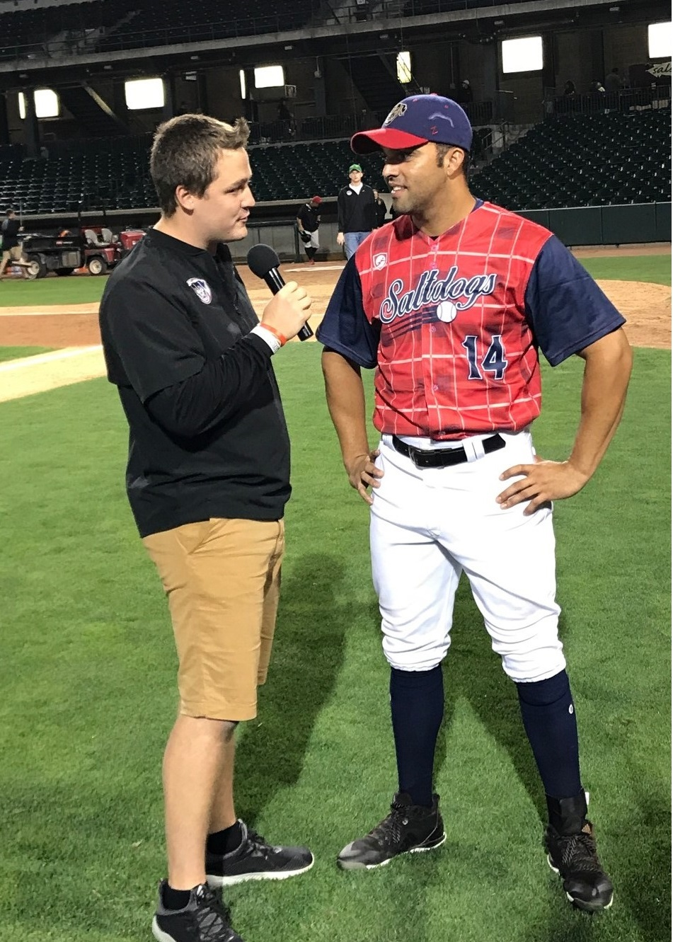 Ryan Schreurs (left) interviews Randolph Oduber, a Salt Dogs baseball player, during Schreurs' internship in summer 2018.