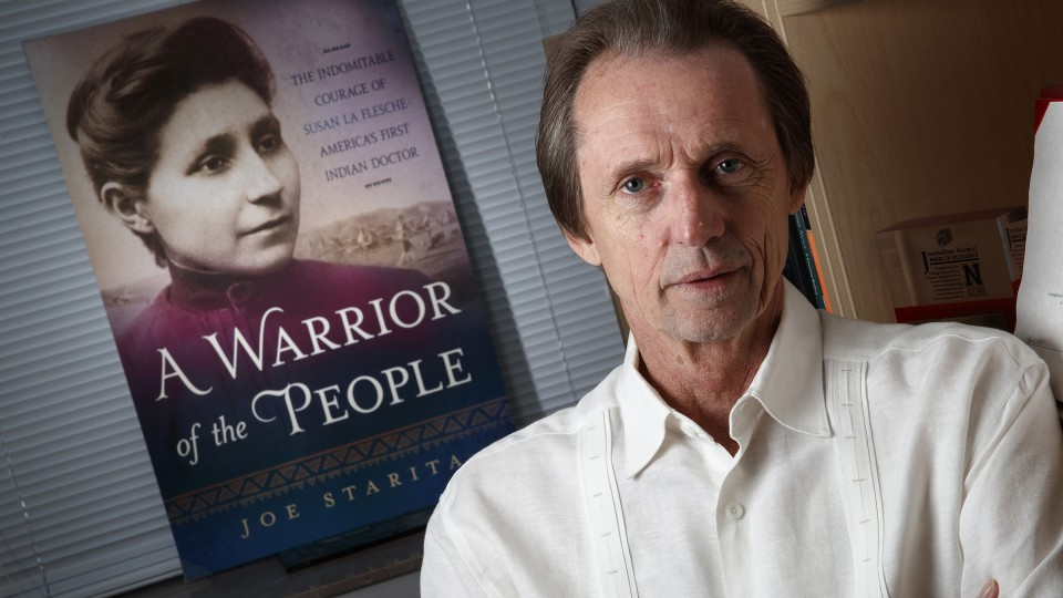Joe Starita and the cover of A Warrior of the People