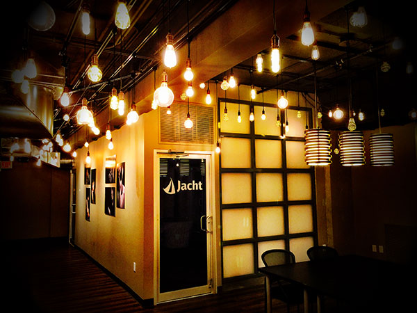 Jacht Ad Lab's door surrounded by hanging lights