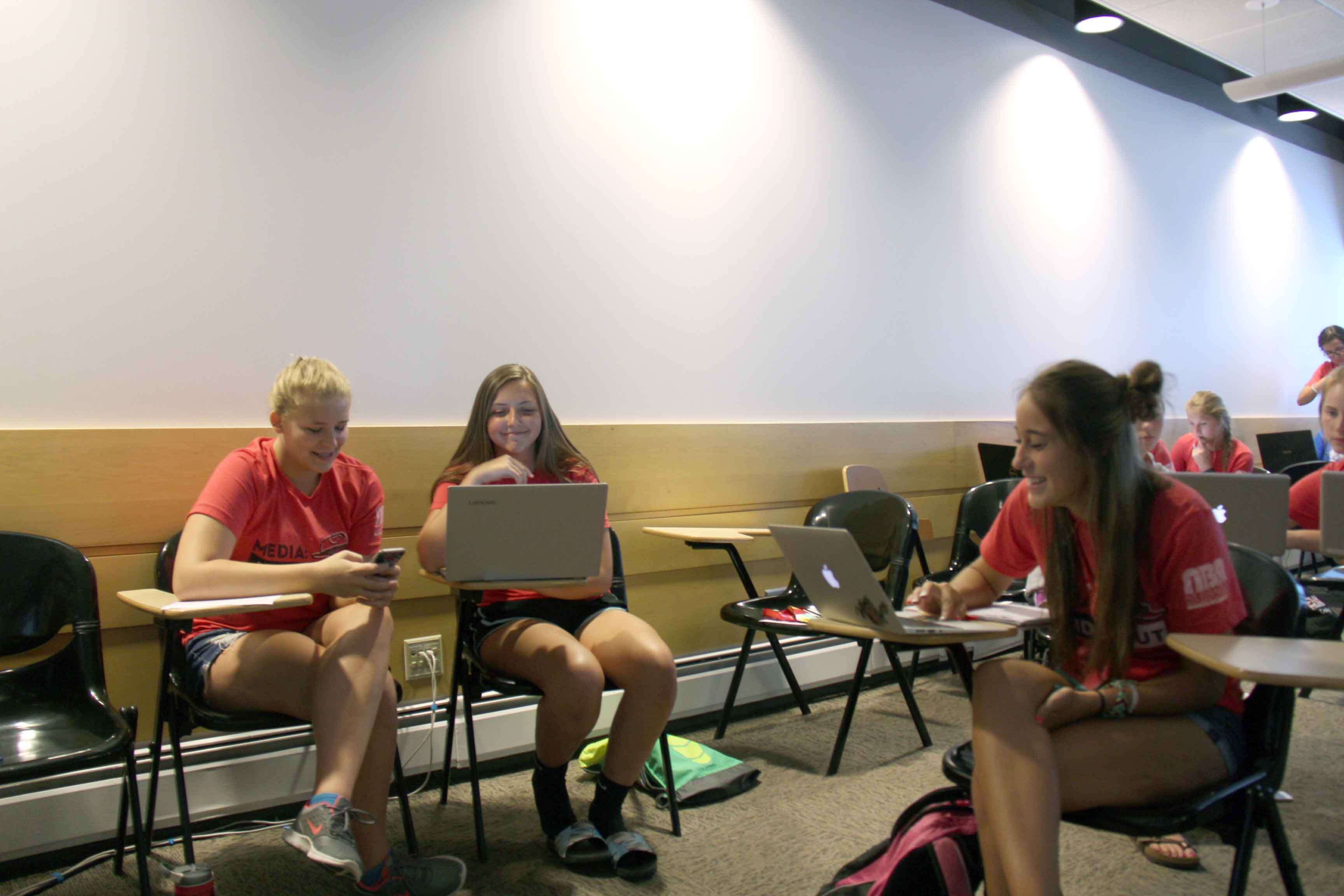 NHSPA Summer Journalism Workshop students work on a group project in the Yearbook Production class