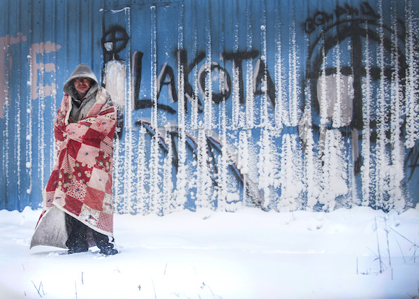Shot of man in snow wrapped in blanker