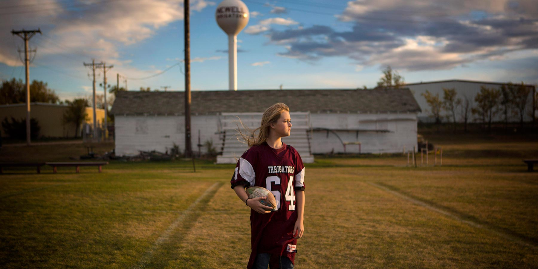 Rachel Boesem, a linebacker for the Newell Irrigators, plays football for her high school team with the same jersey number (64) as her late brother, Donovan