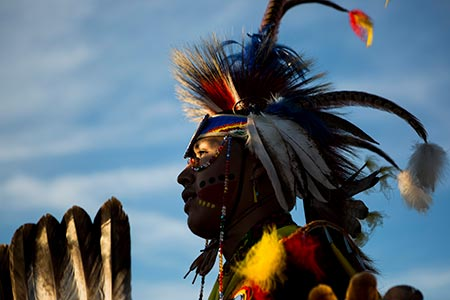 A Native American man participates in a powwow dance at the Crow Fair in Crow Agency, Montana