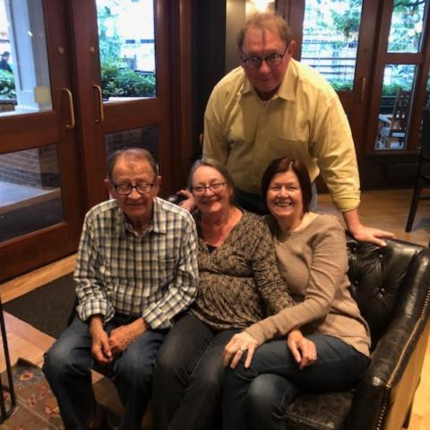 alums Mark Getzfred and Liz Austin reconnected with emeritus professor Mike Stricklan and his wife Cheri in Portland