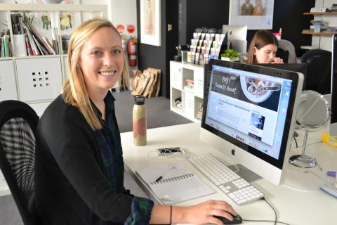 Novak at her desk while working on a project for Urban Walk About. (Photo courtesy of Sydney Novak)