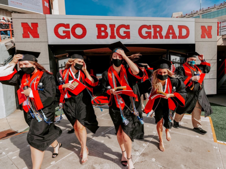 Photo by University Communications, CoJMC students running out of memorial stadium tunnel